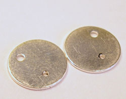 the pierced silver discs